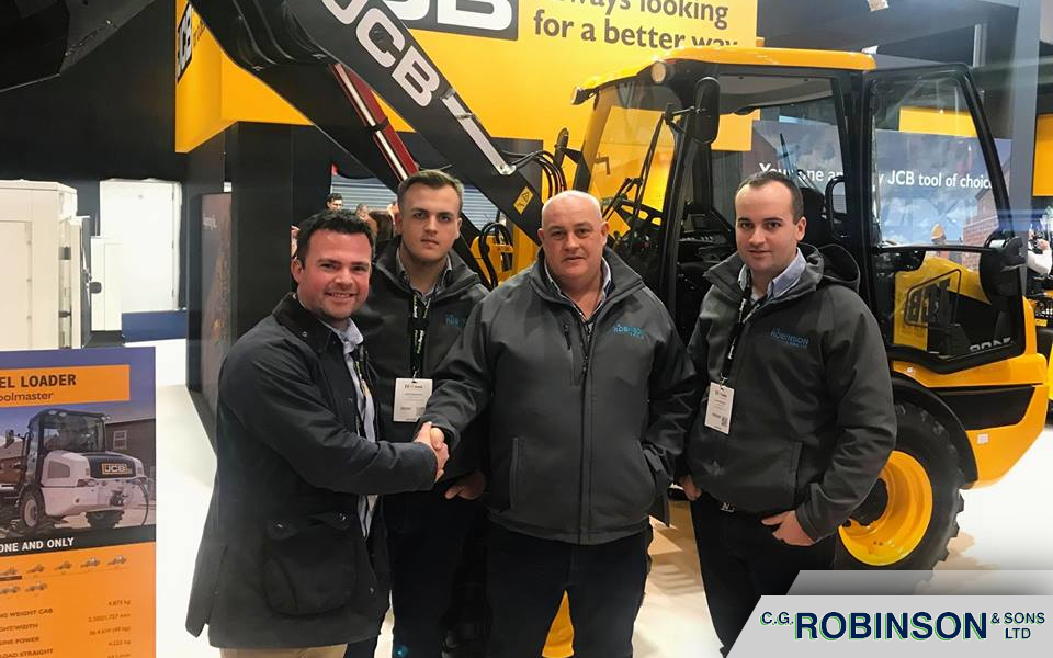 Craig, Jai & Joe shake on a deal for new JCB machines at the executive hire show.